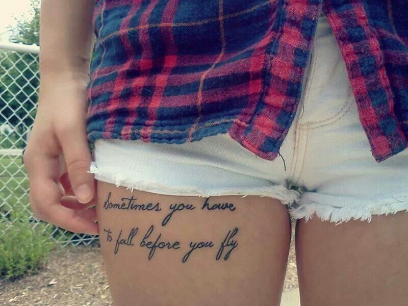 Wonderful flying Tattoo quotes on thigh